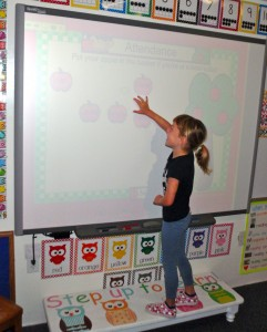 A student familiarizes herself with the SMART Board.
